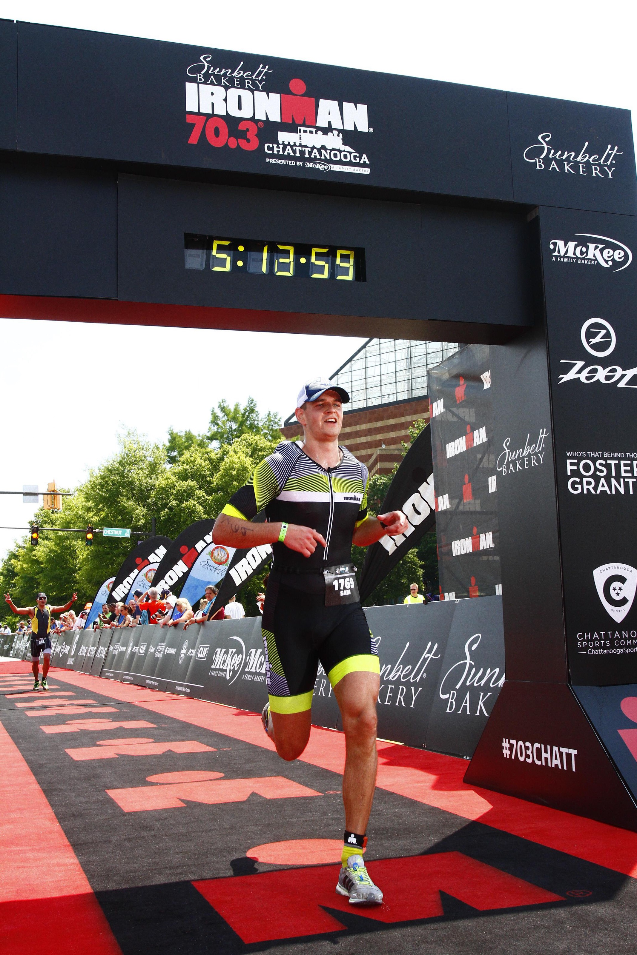 Crossing the finish line at Ironman Chattanooga